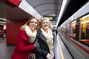 Two beautiful women at the underground platform, travelling