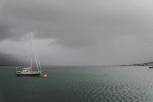 Sailboat under dark clouds