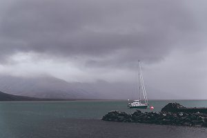 Dark clouds and sailboat in Winter