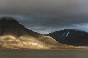 Autumn light over mountain range