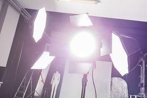 Photo studio with professional lighting equipment.