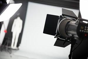 Photo studio with lighting equipment.