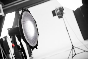 Photography studio with professional lighting equipment.
