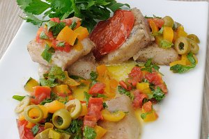 Sliced ​​fish with vegetables