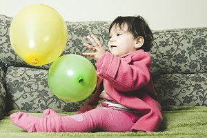 Baby play with balloon