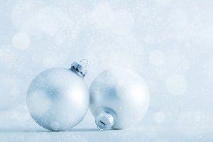 Christmas glass balls on cold frosty glitter background