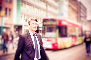 Businessman Using Public Transport