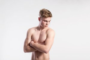 Handsome shirtless fitness man, arms crossed. Studio shot.