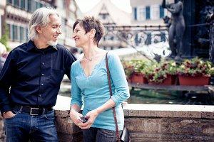 Senior Couple Walking Through The Streets Of Tuebingen