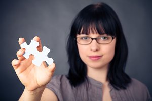 Young Woman With Puzzle Piece