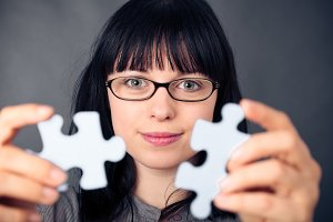 Young Woman With Puzzle Pieces