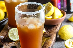 Mexican Michelada. Traditional Latin American mexican spicy refreshing beer drink with lemon juice, salt, ice tabasco and english worcestershire sauce