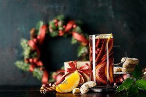 Mulled red wine in holiday composition