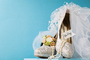 Beautiful arrangement of shoes sand bridal accessories