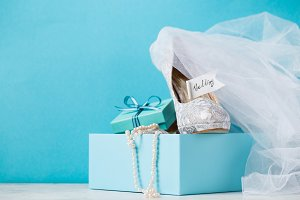 Blue box with bridal shoes in composition