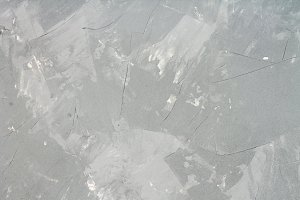 Modern homemade gray texture imitating concrete. Background.