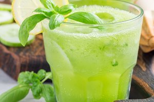 Homemade lemonade with cucumber, basil, lemon, honey and sparkling water, square format