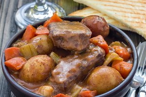 Hearty beef stew with carrot, celery, shallot and potato, square format