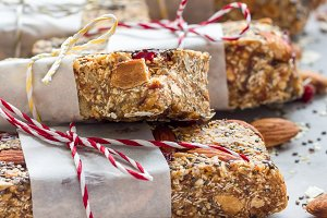 Granola energy bars with figs, oatmeal, almond, dry cranberry, chia and sunflower seeds, square format