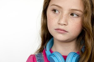 Young girl with headphones close up
