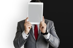 Businessman covered with tablet