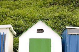 Green beach hut