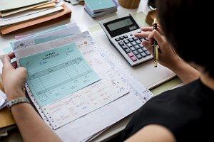 woman working through paperwork