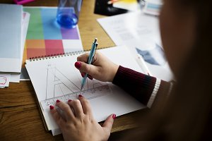 Female hands drawing on a notebook