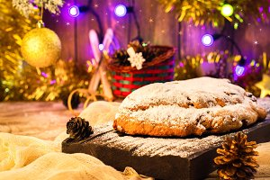 Christmas stollen over festive background. Selective focus