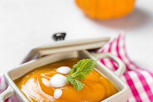 Cream of pumpkin in bowl.
