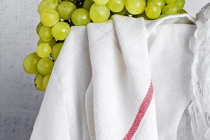 Fresh grapes on white table
