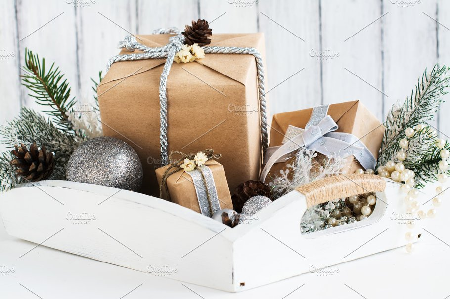 Pile of christmas gift box with decorations on a wooden tray ...