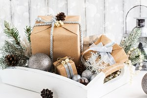 Pile of christmas gift box with decorations on a wooden tray
