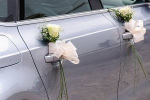 wedding car decorated with roses