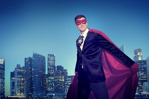 Business people in superhero costume