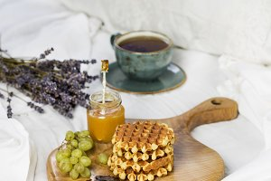 Breakfast with Belgian waffles, apricot jam and coffee
