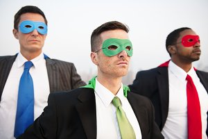Business people in superhero costume