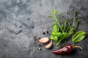 Selectionof herbs and spices on stone background