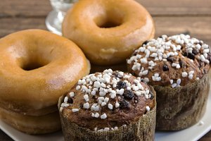Two stacked sugared donuts and muffi