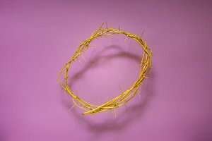 Yellow Crown Of Thorns On A Lilac Background, Top View. Religion worship tradition symbols concept