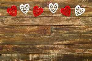 Floral Hearts Hanging over Brown Wooden Background