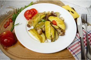 Homemade dish of potatoes. Baked potatoes and vegetables.