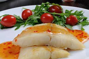 Flounder fillets in sauce