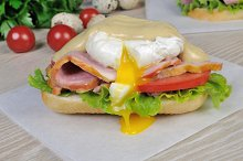 Sandwich with ham and poached egg