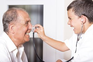 Kid examines his grandfather