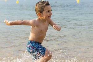 Little boy playing at beach