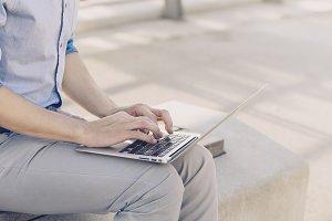 Crop man with laptop
