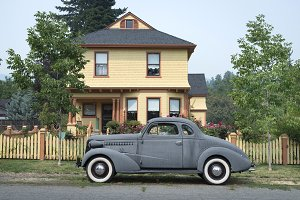 Victorian home with old car
