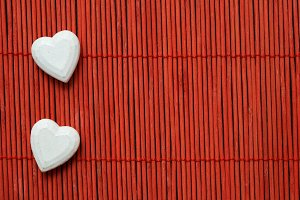 Two hearts on red bamboo lined