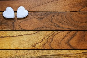 Two hearts with wooden background